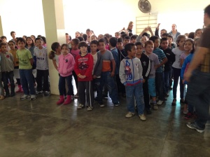 "Elementary school children lining up to sing ""Here Comes the Sun"" for us"